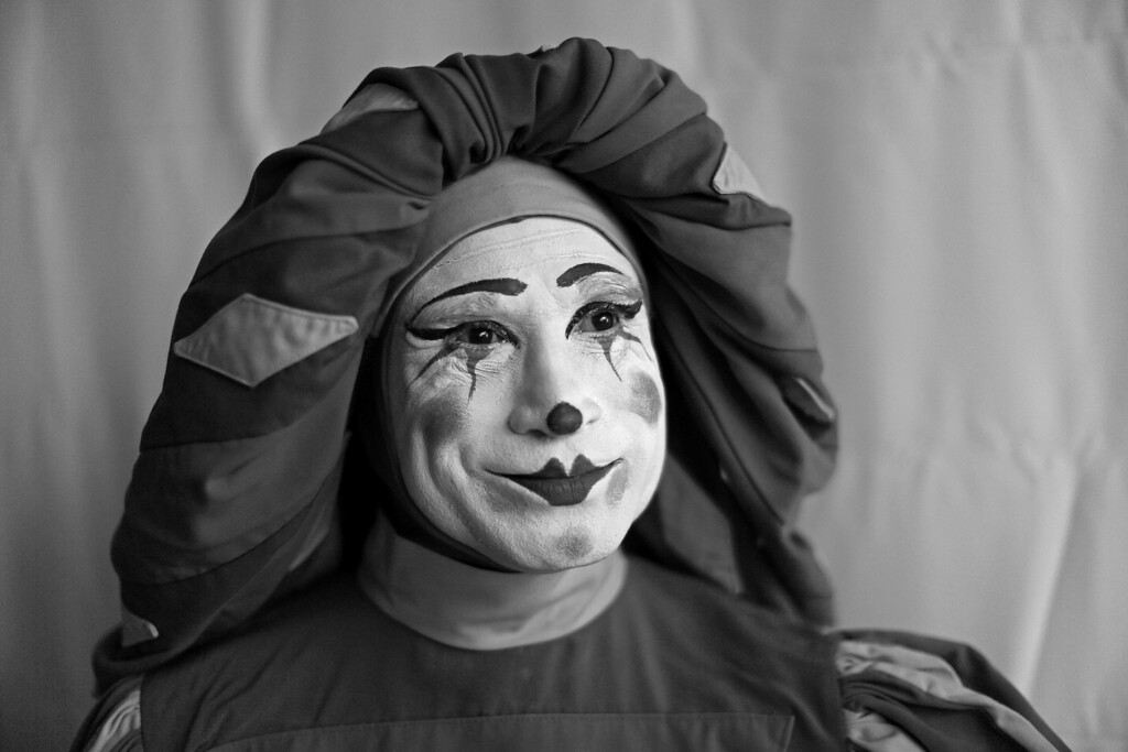 . In this Monday, Oct. 21, 2013 photo, Mexican clown Mimo Jazzo poses for a portrait at the 17th International Clown Convention in Mexico City. Despite their elaborate face paint, wigs and rubber noses of different sizes, the clowns reveal a slice of the humanity they seek to entertain: happy and sad, pensive and exuberant, playful and macabre. (AP Photo/Dario Lopez-Mills)