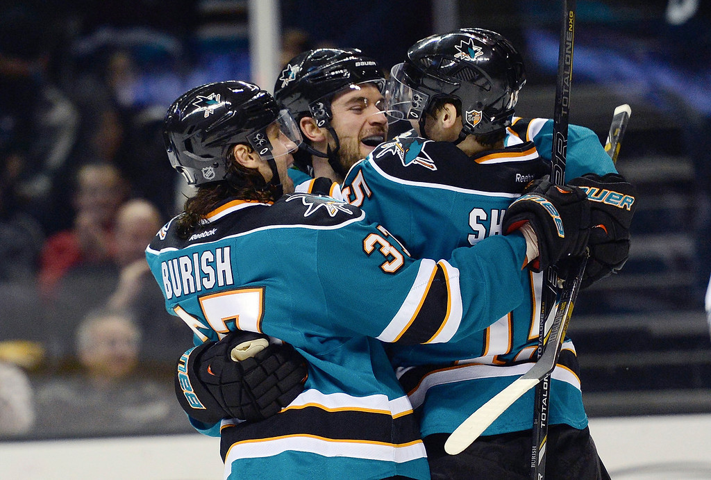 . TJ Galiardi #21, Adam Burish #37 and James Sheppard #15 of the San Jose Sharks celebrates after Galiardi scored a goal against the Colorado Avalanche in the second period at HP Pavilion on February 26, 2013 in San Jose, California. Sheppard got an assist on the play. (Photo by Thearon W. Henderson/Getty Images)
