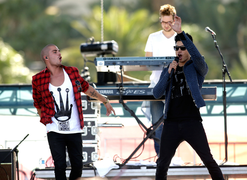 . Max George (L) and Siva Kaneswaran of The Wanted perform onstage during the iHeart Radio Music Festival Village on September 21, 2013 in Las Vegas, Nevada.  (Photo by Isaac Brekken/Getty Images for Clear Channel)