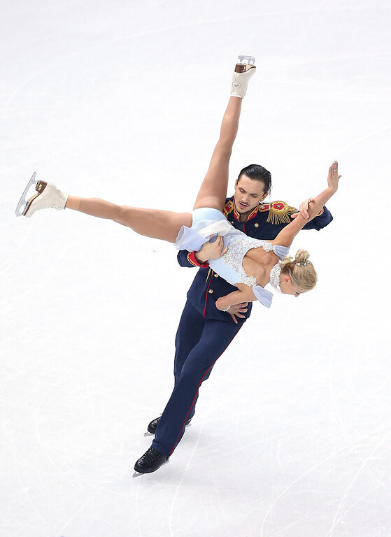 Description of . Tatiana Volosozhar and Maxim Trankov of Russia compete during the Figure Skating Pairs Short Program on day four of the Sochi 2014 Winter Olympics at Iceberg Skating Palace on February 11, 2014 in Sochi, Russia.  (Photo by Matthew Stockman/Getty Images)