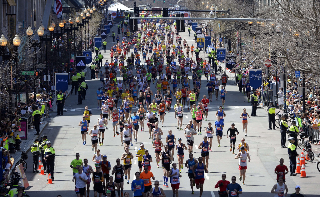 . Runners make their way to the finish line during the 118th Boston Marathon in Boston, Massachusetts April 21, 2014 .  AFP PHOTO / Timothy A. CLARY/AFP/Getty Images