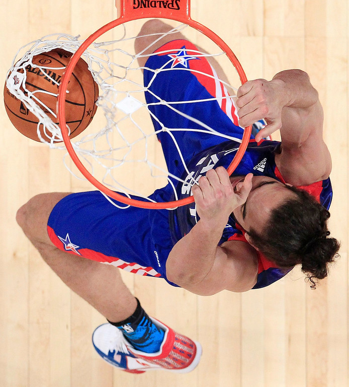 . East Team\'s Joakim Noah from France, of the Chicago Bulls dunks, during the first half of the NBA All-Star basketball game Sunday, Feb. 17, 2013, in Houston. (AP Photo/Lucy Nicholson, Pool)