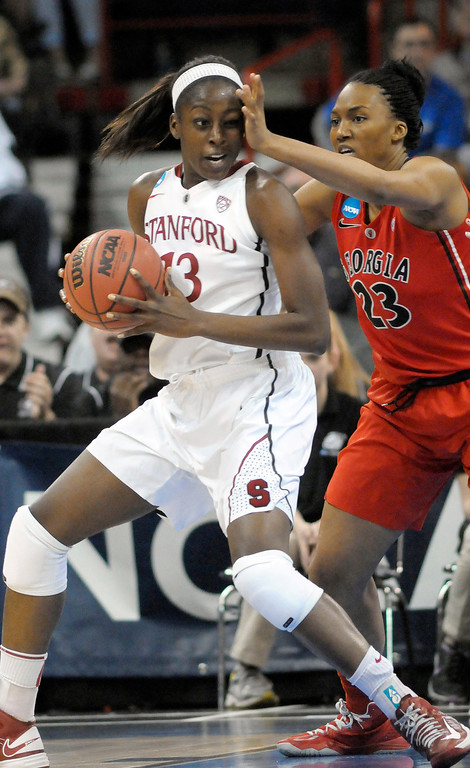 . Georgia\'s Tamika Willis (23) gets hand in the face of Stanford\'s Merritt Hempe (13) during the first half of a regional semifinal in the NCAA women\'s college basketball tournament, Saturday, March 30, 2013, in Spokane, Wash. (AP Photo/Jed Conklin)