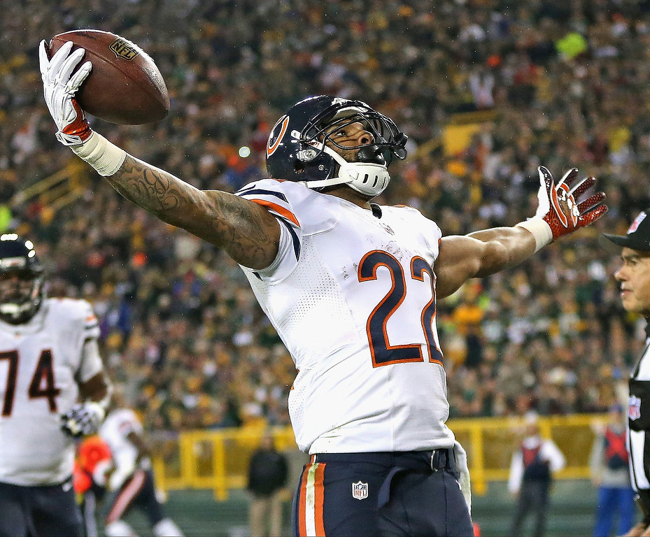 . Matt Forte #22 of the Chicago Bears celebrates a touchdown against the Green Bay Packers at Lambeau Field on November 4, 2013 in Green Bay, Wisconsin.  (Photo by Jonathan Daniel/Getty Images)