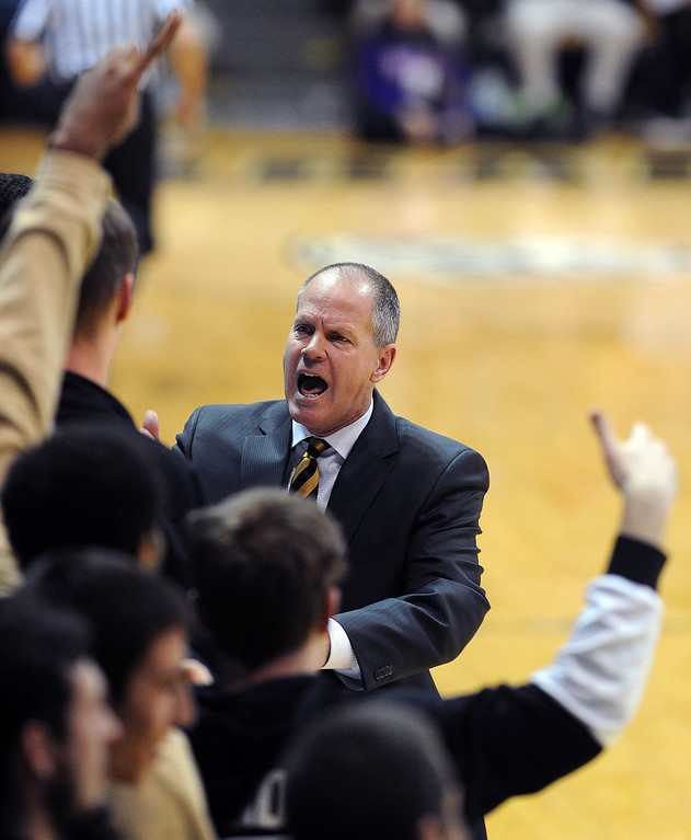 . Colorado head coach, Tad Boyle, gets excited with the bench during the second half of the February 9, 2014 game in Boulder, Colo.  (Cliff Grassmick/Daily Camera)