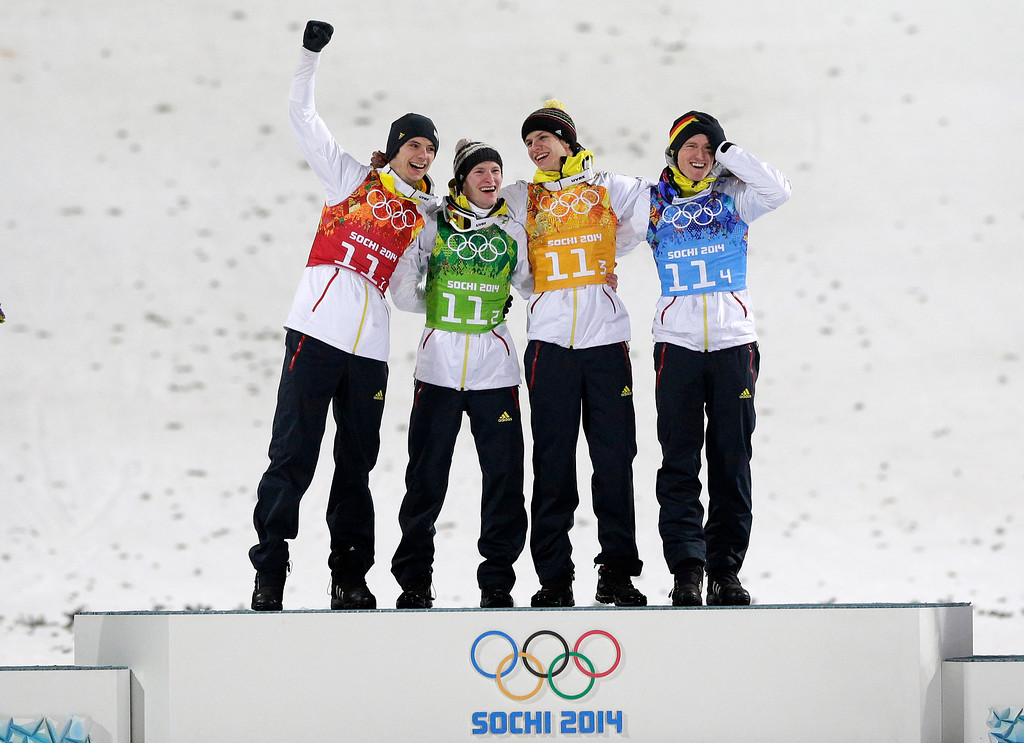. Germany\'s Andreas Wank, Marinus Kraus, Andreas Wellinger and Severin Freund, from left, celebrate on the podium after winning the gold medal during the ski jumping large hill team competition at the 2014 Winter Olympics, Monday, Feb. 17, 2014, in Krasnaya Polyana, Russia. (AP Photo/Matthias Schrader)