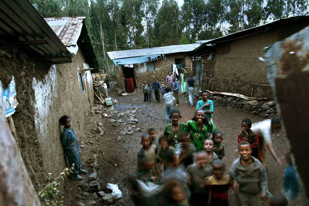 . GONDAR, ETHIOPIA - APRIL 30: Ethiopian Jewish villagers gather outside their homes on April 30, 2007 in Gondar in northern Ethiopia. Some 2,500 Ethiopians of Jewish origin from this province remain in the East African country as Israel slowly brings them over, a few dozen at a time, on commercial flights. Since 1984, more than 73,000 Ethiopian Jews have been settled in Israel. (Photo by Uriel Sinai/Getty Images)