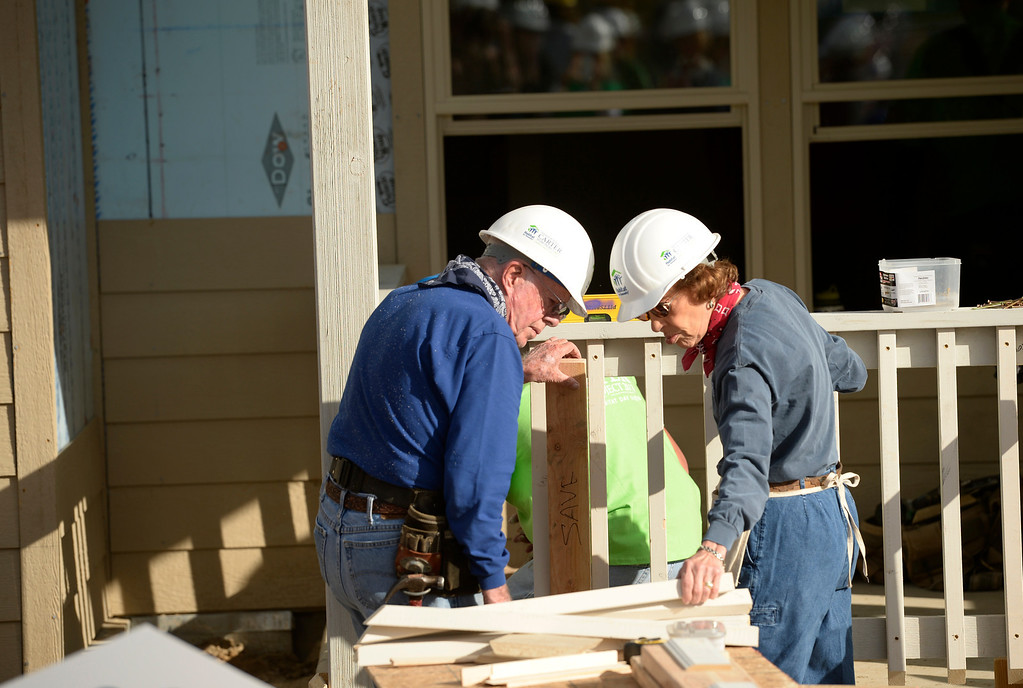 . DENVER, CO - OCTOBER 09: Former president Jimmy Carter and his wife, Rosalynn, work on building a home during Habitat for Humanity\'s Carter Work Project event in the Globeville Neighborhood in Denver, October 09, 2013. Since 1984 the former president and his wife have dedicated a week of their time to help build Habitat homes. (Photo By RJ Sangosti/The Denver Post)