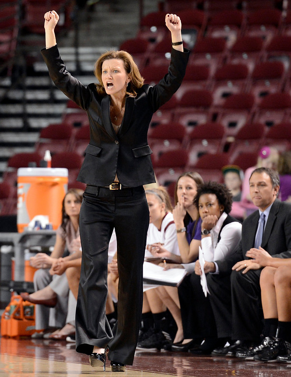 . University of Denver head coach Kerry Cremeans yells two her team during a games against the University of Colorado on Tuesday, Dec. 11, at the Magnus Arena on the DU campus in Denver.   (Jeremy Papasso/Daily Camera)