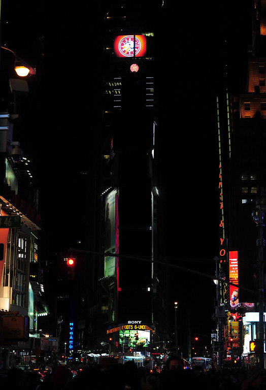 ". Large electronic billboards supporting the New Year\'s ball stand dark on Times Square as their lights were turned off too mark ""Earth Hour\"" in New York, March 23, 2013. More than 150 countries across the world, switched off their lights for an hour at 20:30 local time to support action to create a sustainable future for the planet. EMMANUEL DUNAND/AFP/Getty Images"