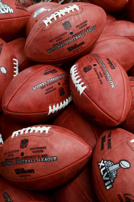 . Footballs selected as actual official game balls for the NFL football Super Bowl XLVII await to be shipped to New Orleans at Wilson Sporting Goods Co. in Ada, Ohio, Monday, Jan. 21, 2013.  (AP Photo/Rick Osentoski)