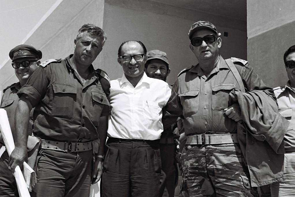 . A photograph supplied by the Israeli Government Press Office (GPO) on 05 January 2014 shows Israeli then Defense Minister Ariel Sharon (L) with Prime Minister Menachem Begin (C) and General Avraham Yoffe (R) in Jebel Livne in the Sinai, Egypt, 07 June 1977. Sharon, who had been in a coma after suffering a stroke and brain haemorrhage on 04 January 2006 while campaigning for re-election, died on 11 January 2014 at the age 85.  EPA/MOSHE MILNER / GPO HANDOUT