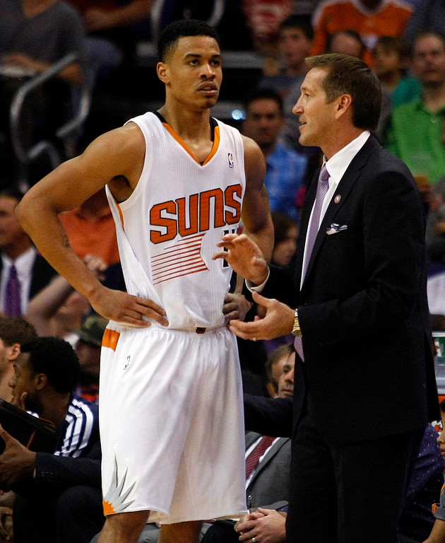 . Phoenix Suns head coach Jeff Hornacek, right, talks to Gerald Green (14) in the third quarter during an NBA basketball game against the Denver Nuggets on Friday, Nov. 8, 2013, in Phoenix. The Suns defeated the Nuggets 114-93. (AP Photo/Rick Scuteri)