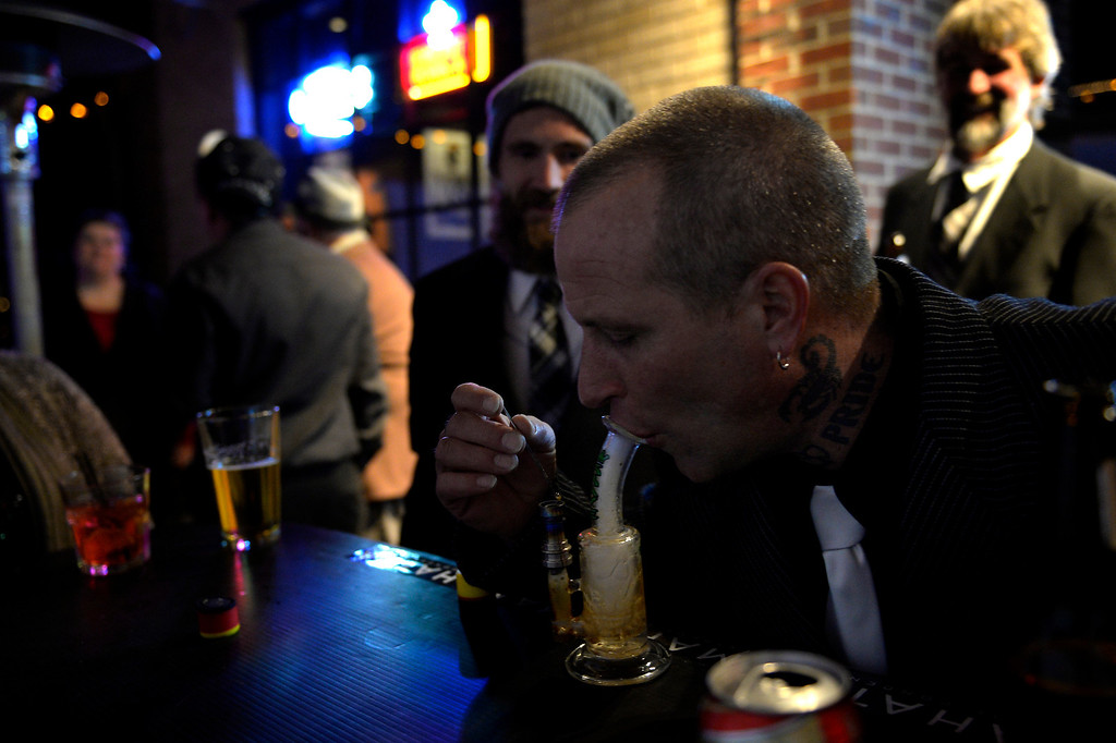 . DENVER, CO. - December 31: Canna Caregivers cultivator Trent Sewell takes a large hit of shatter hash at the Prohibition is Over! party at Casselman\'s Bar and Venue by The Hemp Connoisseur & Mahatma Extreme Concentrates December 31, 2013 Denver, CO. (Photo By Joe Amon/The Denver Post)