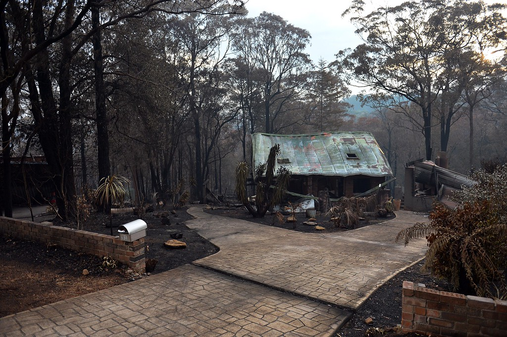 . A view of a gutted house at Winmalee in the Blue Mountains on October 22, 2013.  F   AFP PHOTO/  Saeed KHAN/AFP/Getty Images