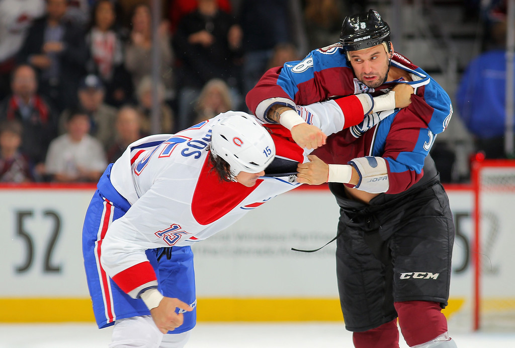 . DENVER, CO - NOVEMBER 02:  George Parros #15 of the Montreal Canadiens and Patrick Bordeleau #58 of the Colorado Avalanche engage in a fight in the first period at Pepsi Center on November 2, 2013 in Denver, Colorado.  (Photo by Doug Pensinger/Getty Images)