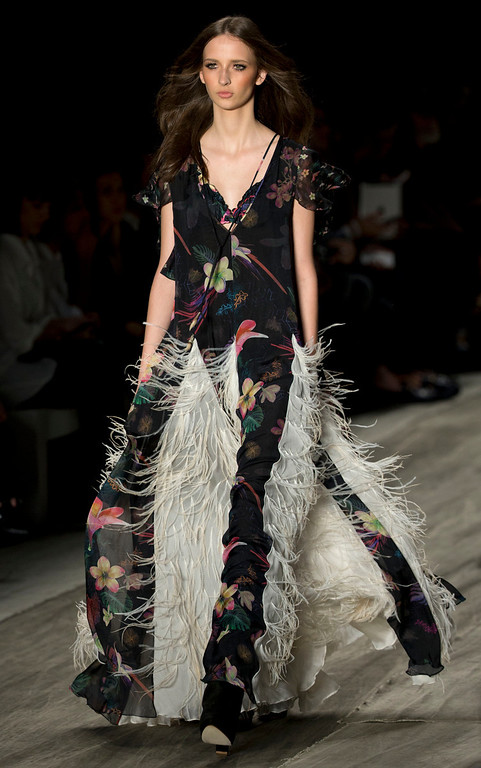 . A model wears a creation from the Cavalera Summer collection at Sao Paulo Fashion Week in Sao Paulo, Brazil, Monday, March 31, 2014. (AP Photo/Andre Penner)