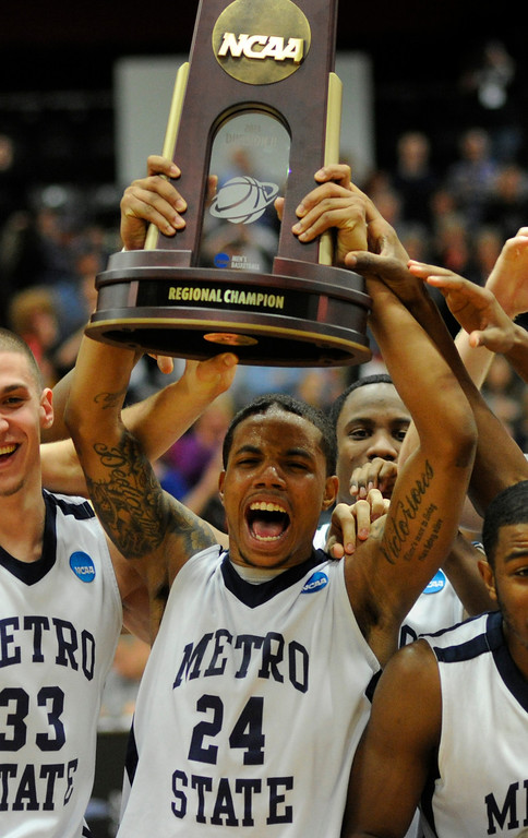 . DENVER, CO. - MARCH 19: Metro State senior guard Demetrius Miller celebrated with the regional trophy Tuesday night. The Metro State men\'s basketball team defeated St. Mary\'s (Texas) 78-70 in a RMAC playoff game Tuesday night, March 19, 2013. With the win the Roadrunners secured the South Central regional championship (Photo By Karl Gehring/The Denver Post)