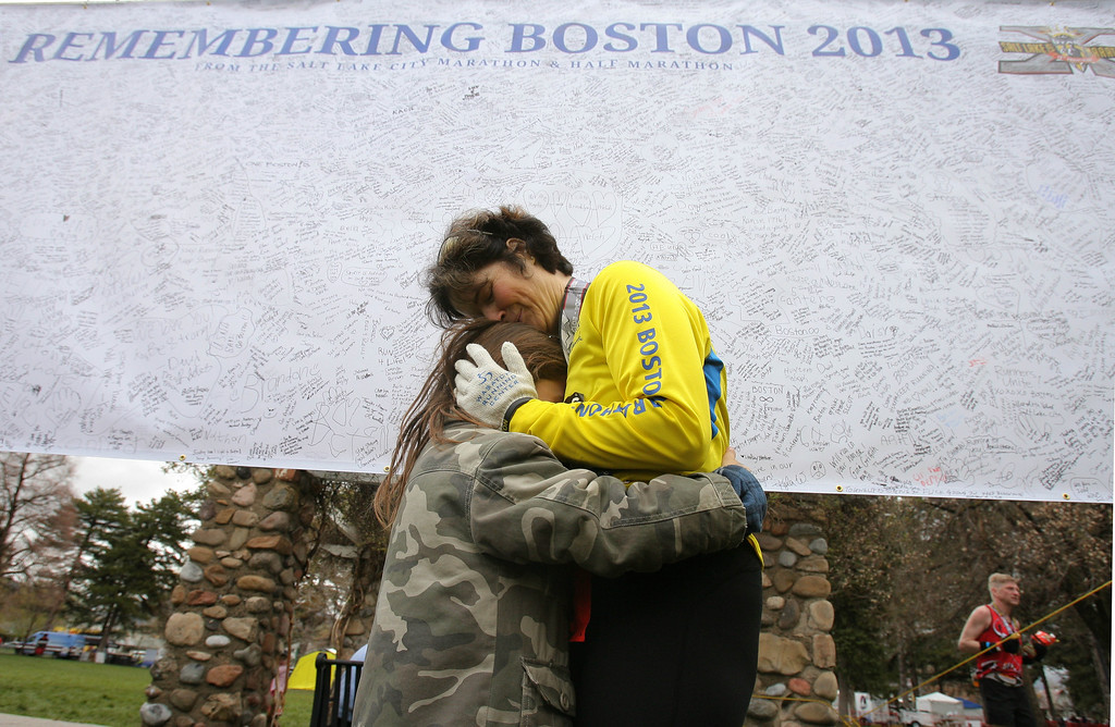 . Zianibeth Shattuck-Owen and her son Ethan Owen hug after she finished the Salt Lake City Marathon, on Saturday, April 20, 2013, Salt Lake City.  Shattuck-Owen, who ran in the Boston marathon, was pulled one mile before the finish of the race because of the bombings. (AP Photo/Melissa Majchrzak)