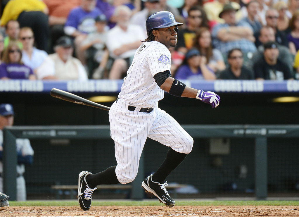 . Denver, CO. - June 08: Eric Young of Colorado Rockies (1) singles in the 3rd inning of the game against San Diego Padres at Coors Field. Denver, Colorado. June 8, 2013.  (Photo By Hyoung Chang/The Denver Post)