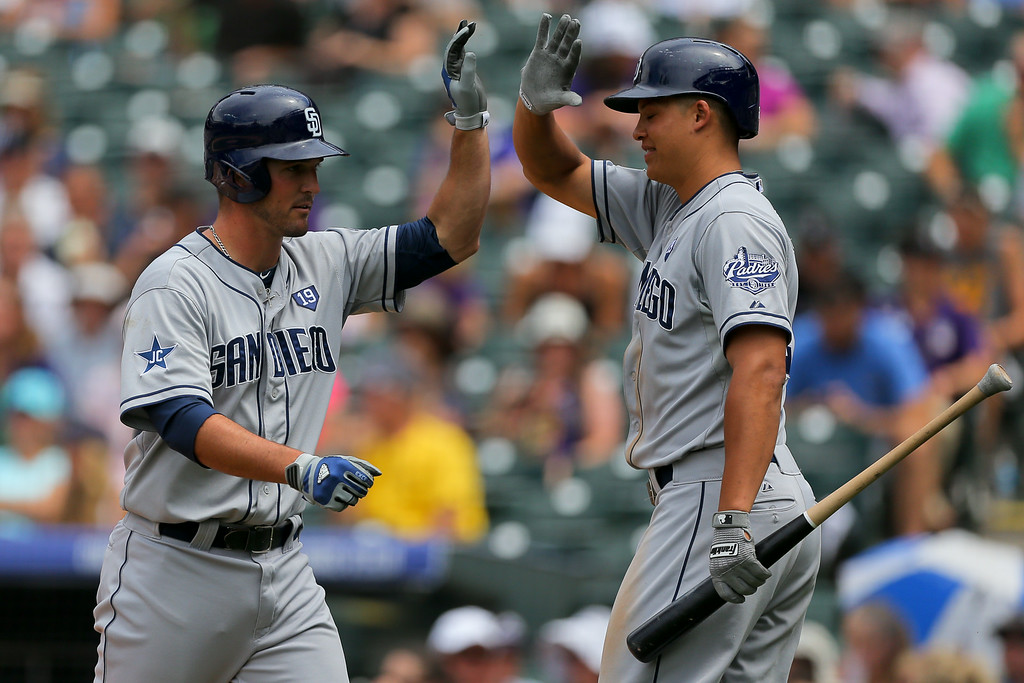 . DENVER, CO - JULY 9:  Jake Goebbert #4 of the San Diego Padres is congratulated by Will Venable #25 after hitting a home run during the fourth inning against the Colorado Rockies at Coors Field on July 9, 2014 in Denver, Colorado. (Photo by Justin Edmonds/Getty Images)