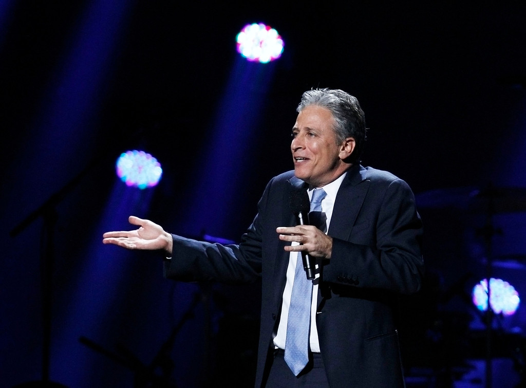 ". Comedian Jon Stewart speaks during the ""12-12-12\"" benefit concert for victims of Superstorm Sandy at Madison Square Garden in New York December 12, 2012.  REUTERS/Lucas Jackson"