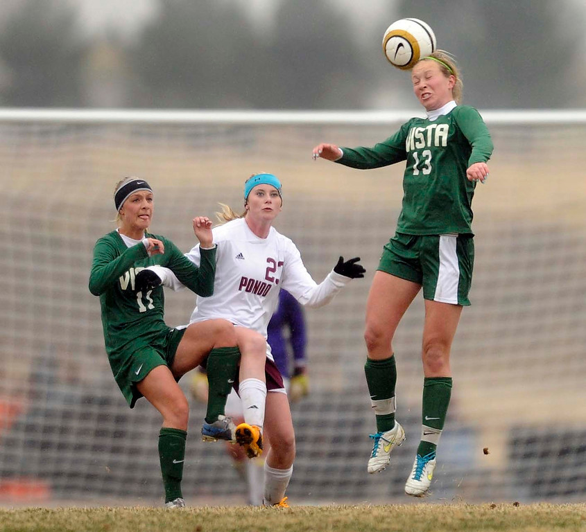. Golden Eagle midfielder Jess Stolz (13) headed the ball in the first half. The Mountain Vista High School girl\'s soccer team defeated Ponderosa 6-0 Tuesday night, April 2, 2013.  Photo By Karl Gehring/The Denver Post)