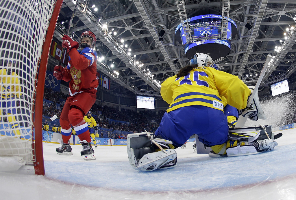 . Russia\'s Anna Shukina scores during the Women\'s Ice Hockey Group B match Sweden vs Russia at the Shayba Arena at the Sochi Winter Olympics on February 13, 2014 in Sochi.   BRIAN SNYDER/AFP/Getty Images