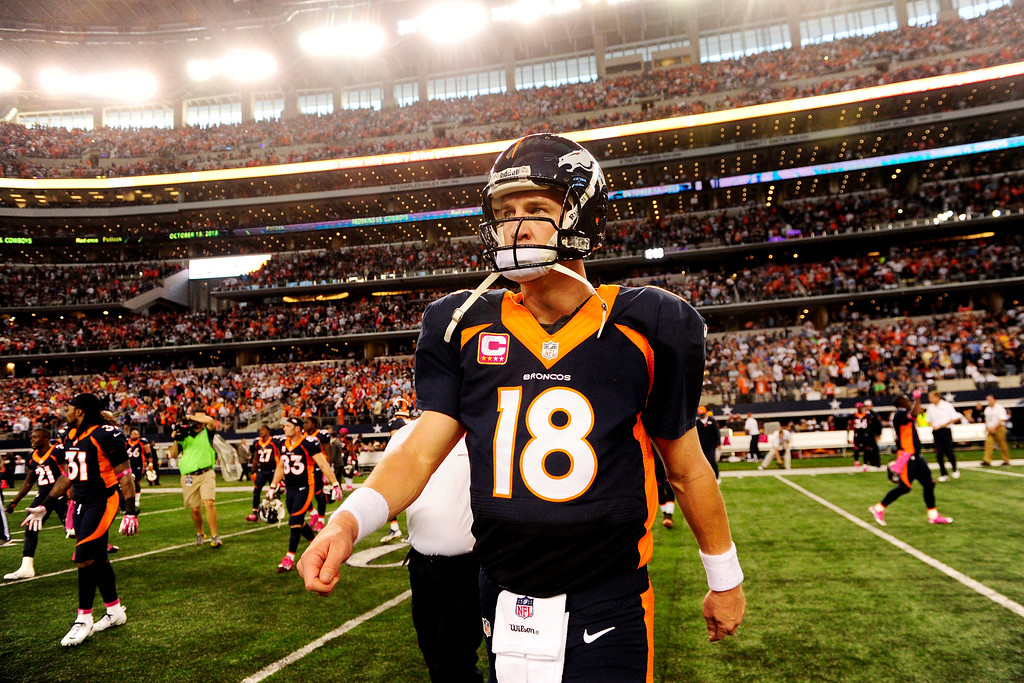 . Peyton Manning (18) of the Denver Broncos walks off the field after the Broncos\' 51-48 win over the Dallas Cowboys at AT&T Stadium.   (Photo by AAron Ontiveroz/The Denver Post)