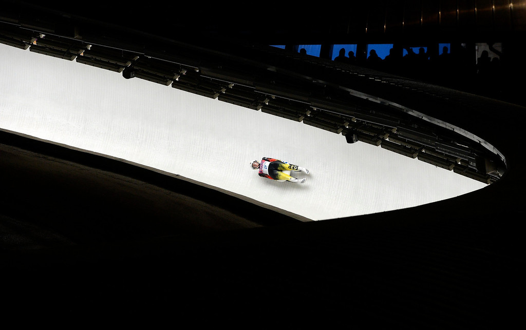 . epa04070267 Gold medalist Natalie Geisenberger of Germany in action during the fourth run of the Women\'s Singles Luge competition at the Sanki Sliding Center at the Sochi 2014 Olympic Games, Krasnaya Polyana, Russia, on Feb. 11, 2014.  EPA/VASSIL DONEV
