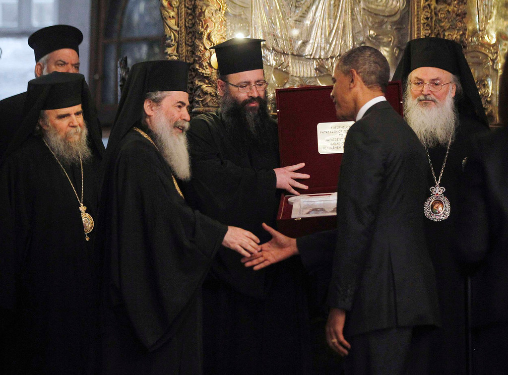 . U.S. President Barack Obama (2nd R) meets Greek Orthodox Patriarch Theophilos III (3rd L) during a tour of the Church of the Nativity in Bethlehem March 22, 2013.   REUTERS/Jason Reed