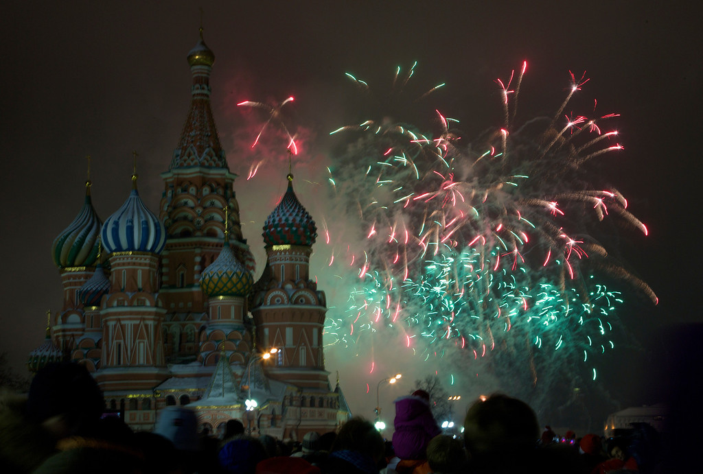 . Fireworks explode in the sky over St. Basil Cathedral as Russians celebrate New Year on Red Square in Moscow, Russia, on Tuesday, Jan. 1, 2013. (AP Photo/Ivan Sekretarev)