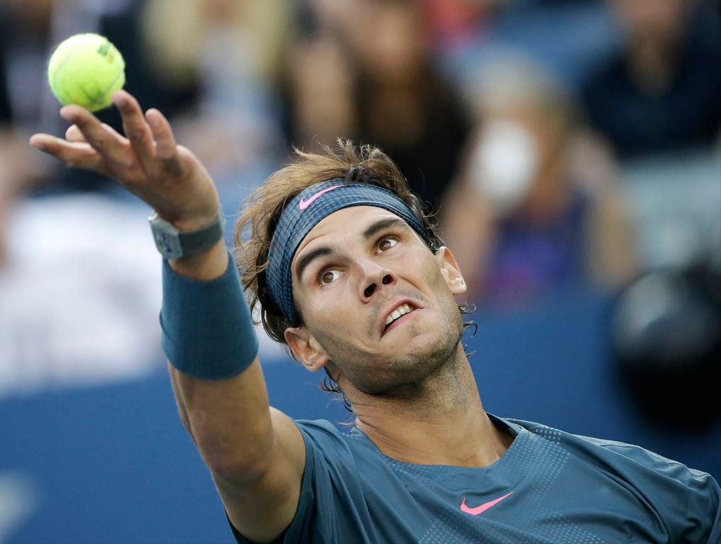 . Rafael Nadal, of Spain, serves against Novak Djokovic, of Serbia, during the men\'s singles final of the 2013 U.S. Open tennis tournament, Monday, Sept. 9, 2013, in New York. (AP Photo/David Goldman)