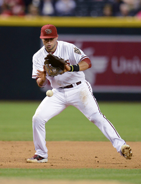 . Martin Prado #14 of the Arizona Diamondbacks fields a ground ball against the Colorado Rockies at Chase Field on April 28, 2014 in Phoenix, Arizona.  (Photo by Norm Hall/Getty Images)