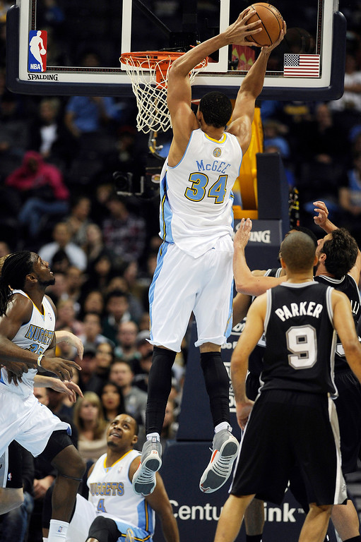 . Andre Miller #24 of the Denver Nuggets slams the ball into the basket against the San Antonio Spurs at the Pepsi Center on November 5, 2013, in Denver, Colorado. (Photo by Daniel Petty/The Denver Post)