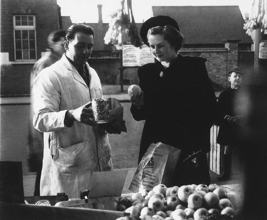 . Youngest election candidate, conservative, Margaret Roberts (later Thatcher) buys a pint of peanuts and studies the quality of a lemon while shopping in Dartford, Kent, England in 1950, where she is standing as Tory M.P. Thatchers former spokesman, Tim Bell, said that the former British Prime Minister Margaret Thatcher had died Monday morning, April 8, 2013, of a stroke. She was 87. (AP Photo, File)