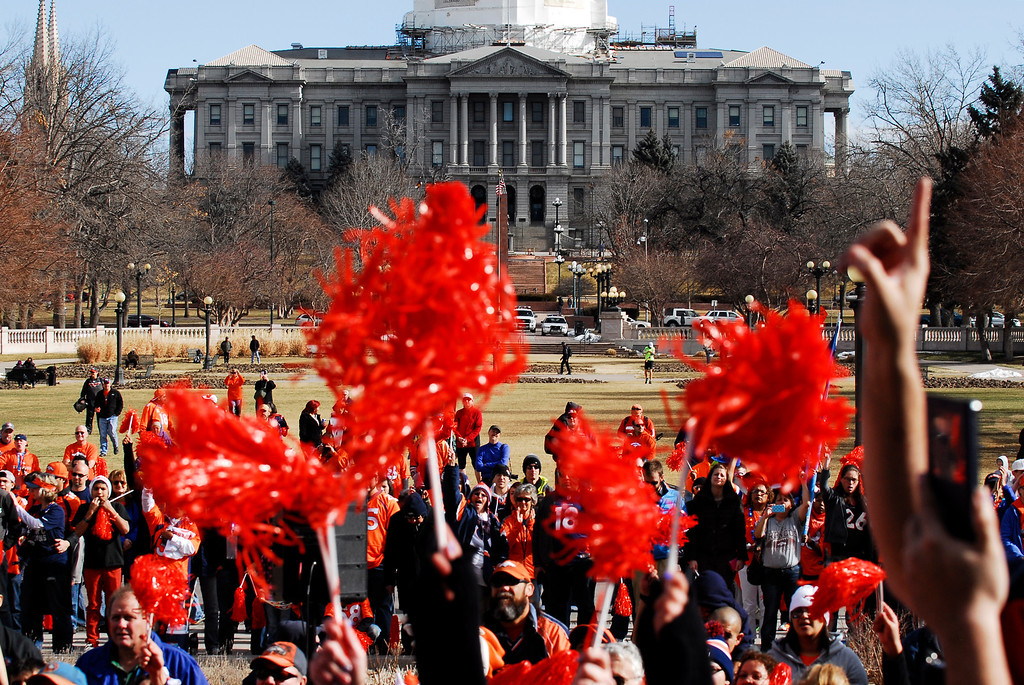 . Fans cheer and wave during a rally to send off the Denver Broncos, at the City and County Building in Denver, Colorado, Sunday, January 26, 2014. The noon rally brought out scores of supporters and included an appearance by Governor John Hickenlooper and Denver Mayor Michael Hancock.  (Photo By Brenden Neville / Special to The Denver Post)