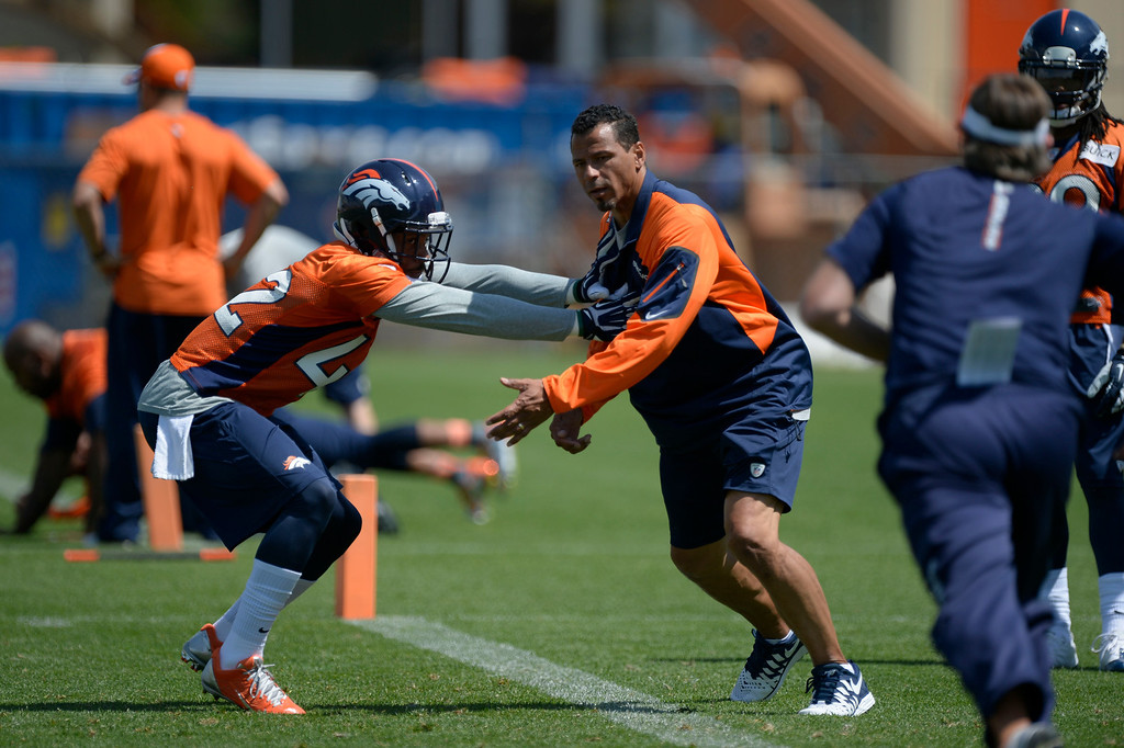 . Denver Broncos Jordan Sullen (42) works on drills with Rod Woodson during OTAs June 11, 2014 at Dove Valley. (Photo by John Leyba/The Denver Post)