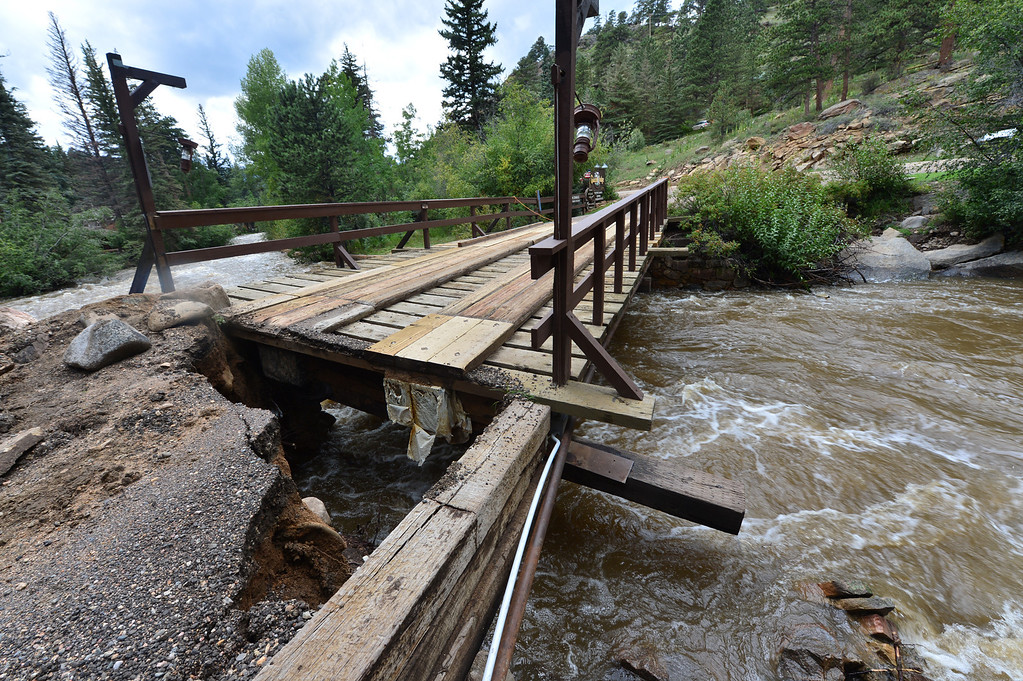 . A bridge over the Big Thompson River sits damaged and unusable on Saturday, Sept 14, 2013, isolating the Glacier Lodge. The bridge withstood years of spring runoff only to be nearly swept away by flood waters this week. Walt Hester/Estes Park Trail-Gazette
