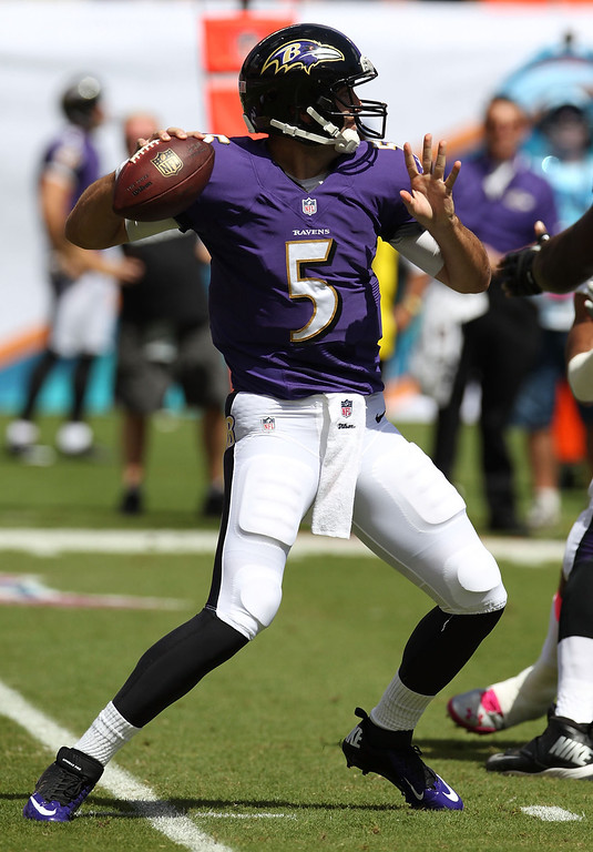 . Quarterback Joe Flacco #5 of the Baltimore Ravens throws against the Miami Dolphins at Sun Life Stadium on October 6, 2013 in Miami Gardens, Florida.  (Photo by Marc Serota/Getty Images)