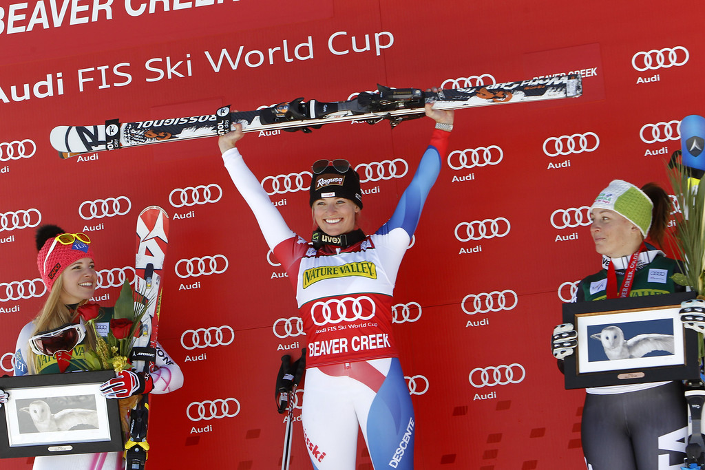 . Lara Gut (C) of Switzerland takes 1st place, Tina Weirather of Liechtenstein (L) takes 2nd and Elena Fanchini of Italy takes 3rd place during the Audi FIS Alpine Ski World Cup Women\'s Downhill on November 29, 2013 in Beaver Creek, Colorado. (Photo by Alexis Boichard/Agence Zoom/Getty Images)