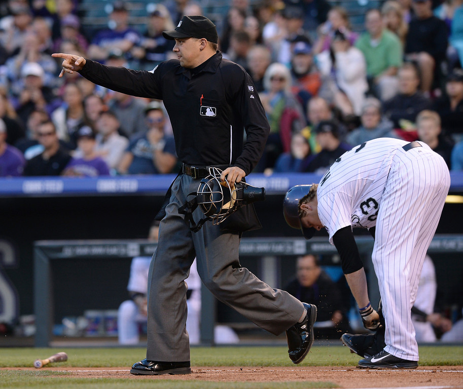 . Home plate umpire Adam Hamari issued a warning to pitcher Matt Cain after he hit Colorado batter Justin Morneau with a pitch in the second inning. The Colorado Rockies hosted the San Francisco Giants Wednesday night, May 21, 2014.  (Photo by Karl Gehring/The Denver Post)