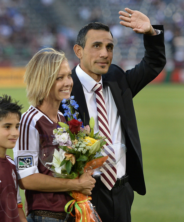 . Colorado coach Pablo Mastroeni acknowledged fans as he was honored with s spot on the team\'s gallery of honor at the stadium Friday night. The Colorado Rapids hosted Chivas USA at Dick\'s Sporting Goods Park Friday night, July 25, 2014. Photo by Karl Gehring/The Denver Post