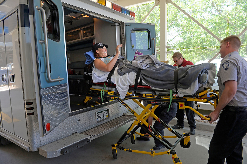 . Amy Van Dyken-Rouen waves as she arrives at Craig Hospital after leaving Scottsdale Healthcare Osborne Medical Center June 18, 2014 by Angel MedFlight. (Photo by John Leyba/The Denver Post)