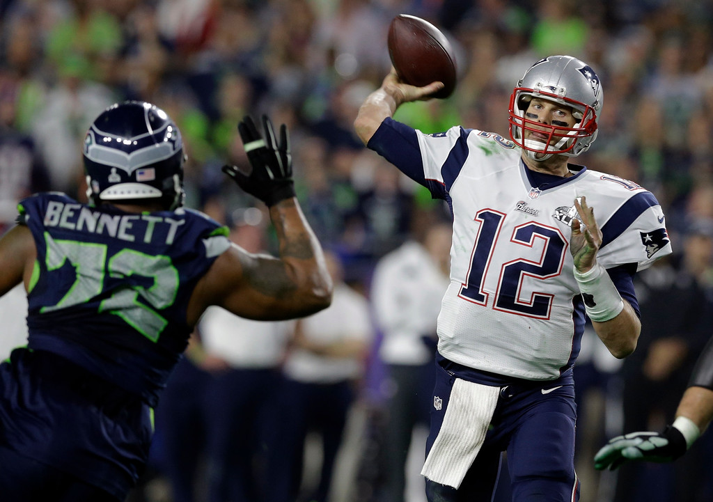 . New England Patriots quarterback Tom Brady (12) throws a pass during the second half of NFL Super Bowl XLIX football game against the Seattle Seahawks Sunday, Feb. 1, 2015, in Glendale, Ariz. (AP Photo/Patrick Semansky)