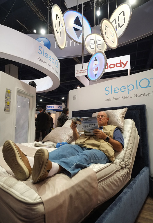. A visitor checks the Sleep IQ bed from Sleep Number during the 2014 International CES at the Las Vegas Convention Center on January 8, 2014 in Las Vegas, Nevada. CES, the world\'s largest annual consumer technology trade show, runs through January 10 and is expected to feature 3,200 exhibitors showing off their latest products and services to about 150,000 attendees. AFP PHOTO/JOE KLAMAR/AFP/Getty Images