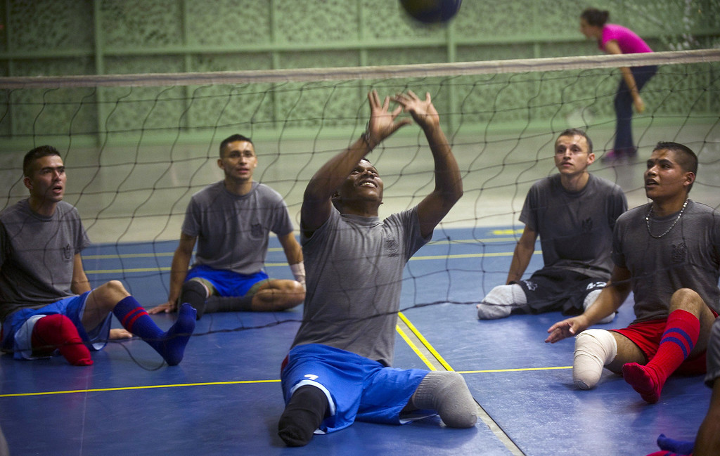 . Colombian soldier Aldemar Benitez (C), 23, victim of a land mine seven months ago, plays volleyball during the rehabilitation therapy session at the Heroes de Paramillo hospital in Medellint, Colombia.   RAUL ARBOLEDA/AFP/Getty Images