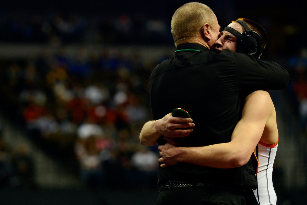 . DENVER, CO - FEBRUARY 23: Del Norte 152-pounder Shawn Beiringer hugs his dad, Ron, after beating Tray Sickels of Nucla 6-2 in the class 2A final during the Colorado State High School Wrestling Championships. The state\'s top wrestlers squared off in four classes in front of a near-capacity crowd at the Pepsi Center. (Photo by AAron Ontiveroz/The Denver Post)