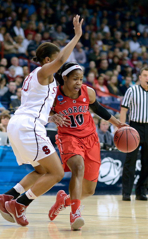 . Georgia\'s Jasmine James (10) drives against Stanford\'s Amber Orange in the first half of a regional semifinal game in the NCAA women\'s college basketball tournament, Saturday March 30, 2013 in Spokane, Wash. (AP Photo/Jed Conklin)