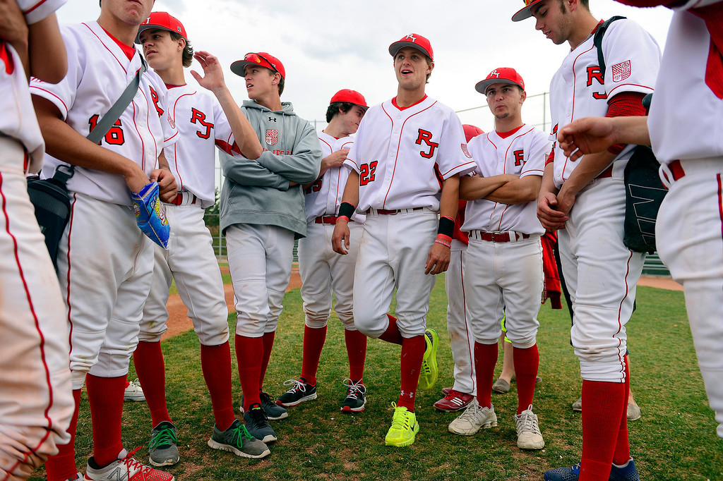 . PARKER, CO - APRIL 29: Regis Jesuit shortstop Brody Weiss (22) stands with teammates following the team\'s final home game. Weiss is the son of Colorado Rockies manager Walt Weiss. (Photo by AAron Ontiveroz/The Denver Post)